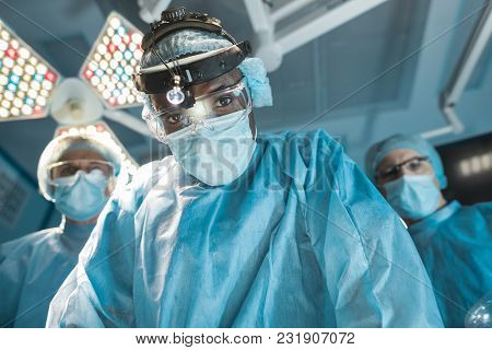 Bottom View Of African American Surgeon Looking At Camera