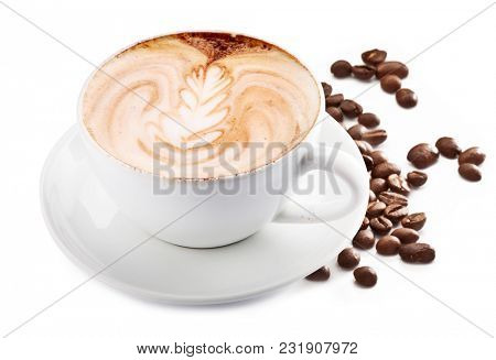 Cup of cappuccino coffee and coffee beans. White background.