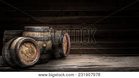 Wine barrels on the old wooden table. Wine background.