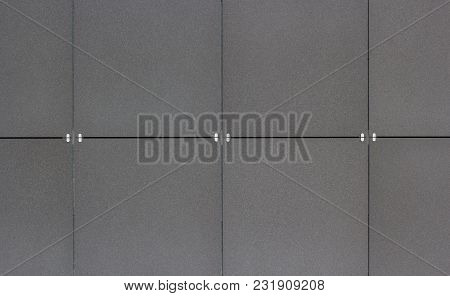 Brushed Metal Tiled Panels At The Wall