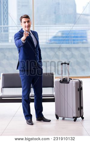 Businessman waiting at the airport for his plane in business cla