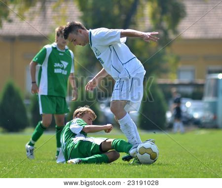 KAPOSVAR, HUNGARY - SEPTEMBER 5: Unidentified players in action at the Hungarian National Championship under 19 game Kaposvar (white) vs. Nagyatad (green) September 5, 2011 in Kaposvar, Hungary.