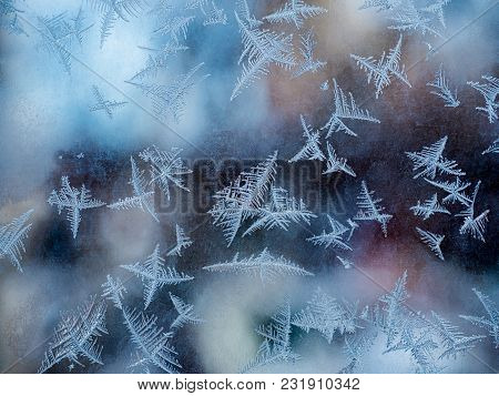 Intricate Patterns Of Frost On Window Glass In Winter