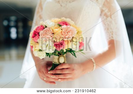 Wedding Bouquet Of Flowers In The Hands Of The Bride 1
