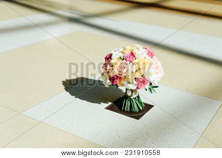 Wedding Bouquet Of Flowers With Rings Of The Newlyweds 1