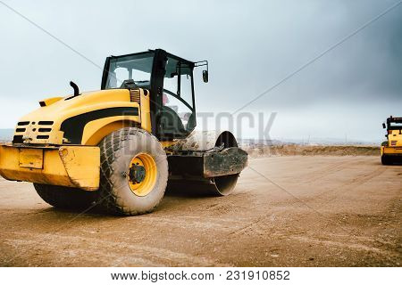 Tandem Road Roller Vibroroller Finishing The Earth Layer At Road Construction