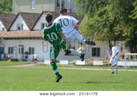 KAPOSVAR, HUNGARY - SEPTEMBER 5: Krisztian Garai (in white) in action at the Hungarian National Championship under 19 game Kaposvar (white) vs. Nagyatad (green) September 5, 2011 in Kaposvar, Hungary.