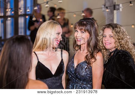 Three Beautiful Mature Women At A Party