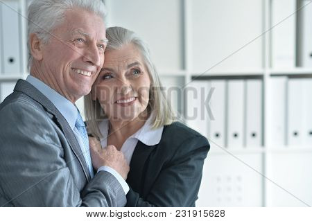 Portrait Of Senior Man And Woman In Formal Wear At Office