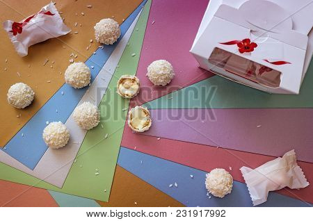 Delicious Cookies With Cream Filling On The Background Of Multi-colored Paper Pastel Shades.