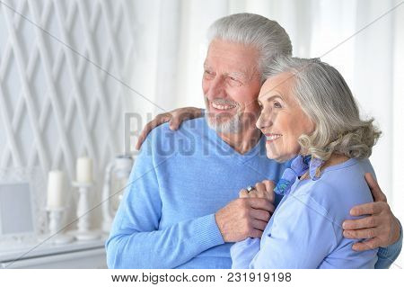 Portrait Of A Happy Senior Couple Hugging At Home