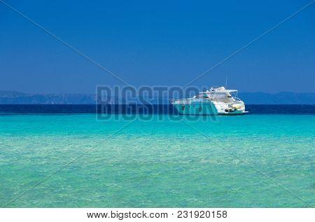Sea coast at sunny day under blue sky