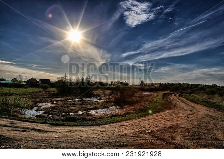 Rural Road, Blue Sky And Sunlight. Landscape Sunny Spring Day