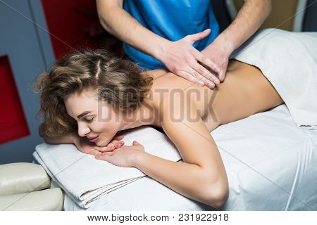 Close Up Cropped Shot Of A Professional Masseuse Working Massaging Back Of A Woman Relaxation Pamper