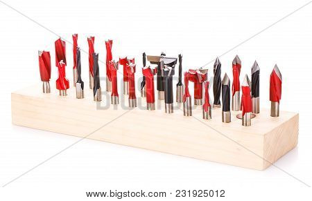 Large Set Of Drill Bits For Wood In Wooden Stand On A White Background