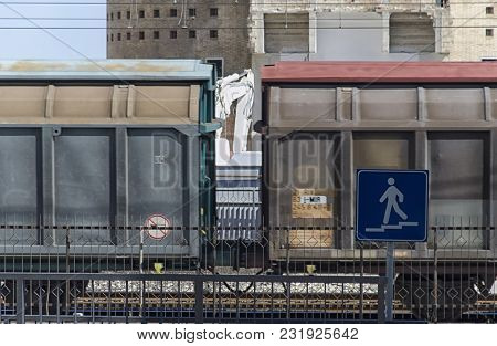 Goods Train Passing In Front Of A Demolished Building