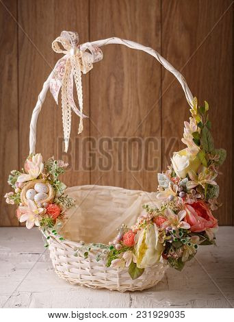 The Basket Is Decorated With Flowers. Decoration For The Interior. Decor For Celebrating Easter. Eas