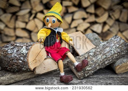 Old Wooden Pinocchio Pupett . Marionette Retro Toy.