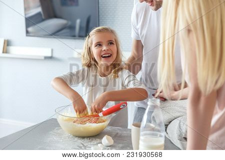 Parents Teaching Their Adorable Happy Daughter To Cook