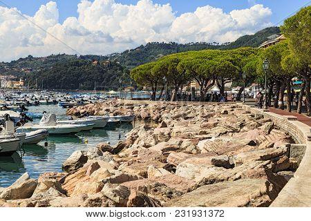 Lerici, Italy, La Spezia Province, Ligurian Riviera - August 07, 2017. Hot Summer .tourists Walk Alo