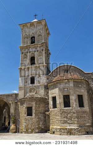 Ancient Church Of Saint Lazarus: Exterior, General View Against The Blue Sky. Orthodox Church In Cyp