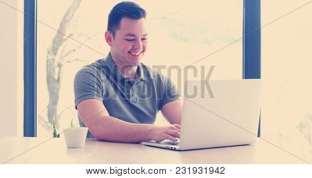 Young Entrepreneur Freelancer Working Using A Laptop In Coworking space