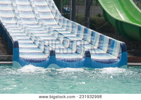 Aqua Park Attraction In Summer Sunny Day.