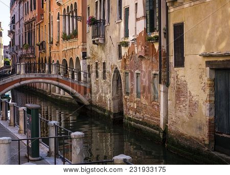A View Of A Quiet Little Canal In Venice, With Soft Light And Lovely Colors.