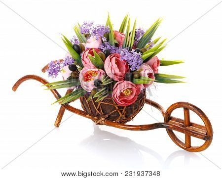 Bouquet, Composition Of Flowers In Decorative Brown Wooden Bicycle On A White Background.