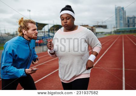 Strict trainer encouraging his trainee to pay more attention to speed