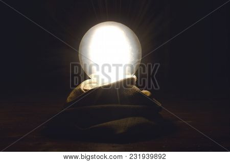 Crystal Ball On Fortune Teller Desk Table Background. Seance Concept. Future Reading.