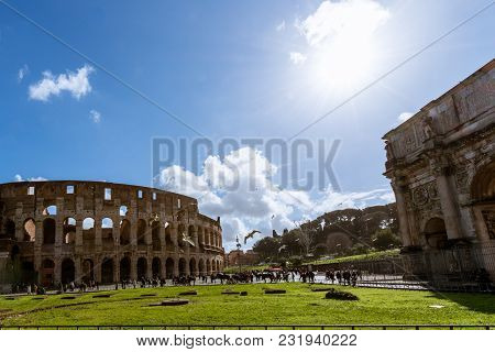 Rome, Italy, March 07, 2018: Wide Angle Picture Of Coliseum, Important Tradmark Of Rome, During Blue