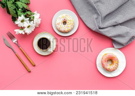 Holiday Lunch For Woman With Cup Of Americano, Donut And Flowers On Pink Table Background Top View M