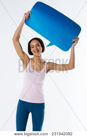 Social Protection. Pleasant Nice Good Looking Woman Showing A Sign And Looking At You While Protecti