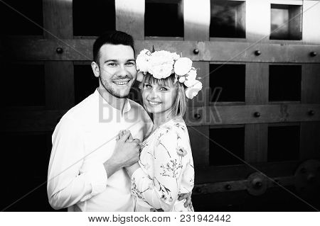 Portrait Of Wedding Couple Standing Isolated On Attractive Architecture . They Holding Their Hands,