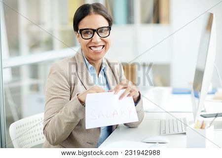 Happy businesswoman getting salary for her work