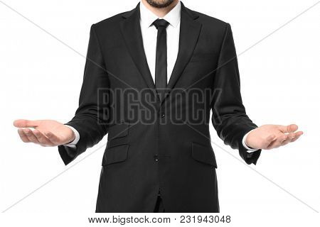 Young businessman showing balance gesture on white background