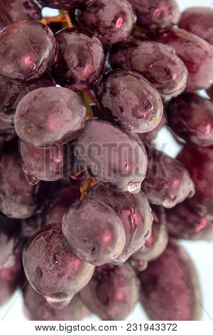 Grapes Blue With A Branch Of Blue Grapes, Close Up, Kernels, Sweet, Dark Red Wine Grapes. Healthy Fo