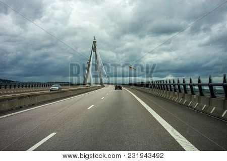 Suspension Bridge Near Udevalla, Sweden With A Slight Motion Blur Effect
