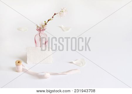 Feminine Spring Stationery Mockup Scene With A Handmade Paper Greeting Card, Spool Of Silk Ribbon An