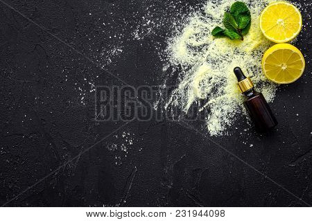 Homemade Spa With Lemon Salt In Natural Cosmetic Set On Black Desk Background Top View Space For Tex
