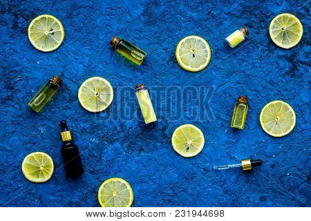 Homemade Spa With Lemon Oil In Natural Cosmetic Set On Blue Desk Background Top View Space For Text
