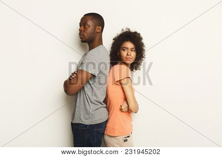 Break Up Or Divorce. Upset Young African-american Couple Standing Back To Back After Quarrel, Isolat