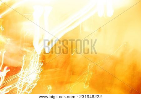 Random abstract light streaks on bright yellow color background.