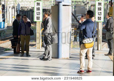 Tokyo Japan - May 9, 2015: Unidentified Poeple Smoke In Designated Smoking Area In Railway Station .