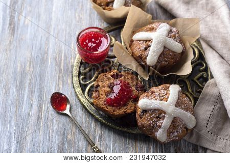 Easter Cross Muffins With Raisins, Cranberries And Raspberry Jam On A Wooden Table, Top View, Free S