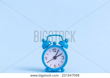 Alarm Clock On Pastel Blue Background. Space For Copy. Minimal Concept.