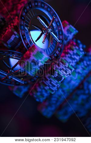 Close Up Of Roulette And Stack Of Chips. Blue Light.  Bokeh Background.