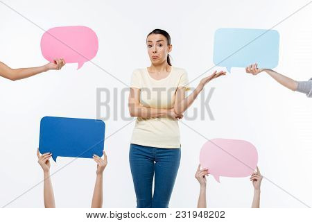 Confused Look. Nice Pleasant Young Woman Looking At You And Feeling Confused While Being At Loss