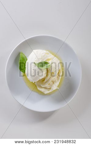 Fresh Italian Mozzarella With Olive Oil On White Plate